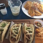 Jerk pork tacos, plantains, and a cocorita (margarita with coconut cream)