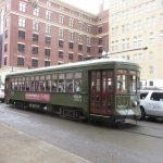 Streetcar with hotel in background