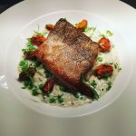 Hake with crab and pea risotto and crispy mussels