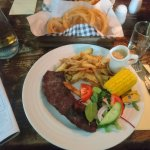Steak, Chips, Salad, Corn, Peppercorn sauce, onion rings and a glass of wine. Excellent.