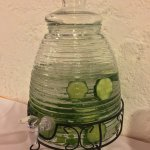 Fresh water carafe with cucumbers, orange, lime, and various fruits