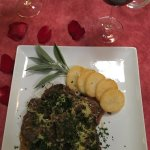Osso Buco accompanied by a Colomin 2013 Malbec. Table was covered with rose petals. Nice touch!