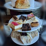 Afternoon tea. Dry scones, boring sandwiches and bought cakes