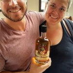 Happy couple with their very own personal flavored rum blend