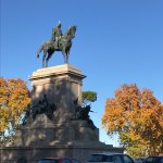 Majestic Mounument of Garibaldi with his soldiers, wreaths at pedestal and autumn trees as backd