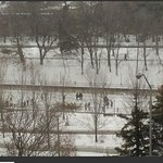 skaters on the canal out the window of meeting room