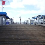 The entry to the pier with the bigger restaurants on either side