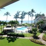 view of pool and ocean from veranda