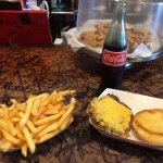 Enjoying my Cheddar Cheeseburger, Fries, and glass bottle of Coke