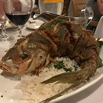 Check out this whole yellow-tail snapper, cooked to perfection. A dinner for two, really
