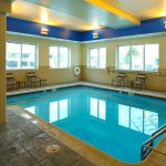 Cozy indoor heated pool, open from 6am-10pm daily, towels and changing room provided