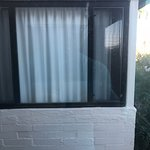 Poor floor plan, safe too high to use and window of next room 10 feet away.