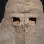 Calico hood circa 1875, worn outside cells.