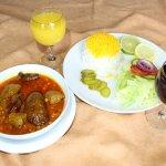Aubergine stew with sauteed onion, diced lamb & split peas.