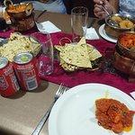 (clockwise from top right) Rassam, Chicken Tikka Masala, Lamb Vindaloo, Butter chicken
