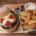 Pizza burger with homemade chips at The Clubhouse