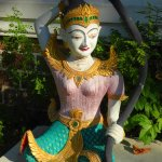 One of the statues in Baan Tawai Village temple compound