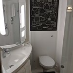 The Bathroom - check out the easily splashed tissues next to the loo & tiny towels