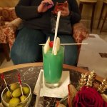 The Cocktail Bar - a green drink and snacks