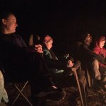Listening to stories around the campfire in February.