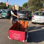 Mathieu on his cargo bike (smiling as always!)