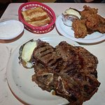 Porterhouse w/ a baked potato. Fried Chicken Dinner and Texas Toast
