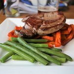 Venison steak with sweet potato fries and green beans
