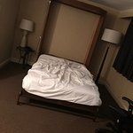 The disgusting room I was put in with an unmade bed at the Sheraton