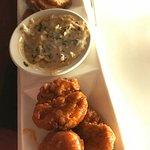 appetizer plate: fried pickles, boneless buffalo wings, hot spinach dip, tortilla chips, veggies
