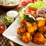 Chicken Tikka Boti: Chicken breast cubes marinated in tikka spices and grilled in a tandoor.