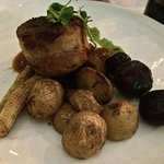 ...Grilled Rabbit wrapped in bacon with baby roasted potatoes, beetroot & coen