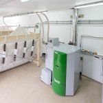 Wood pellet biomass boiler system heating the pool and cottages