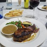 Wonderful fillet steak, with peppercorn sauce and chips. Note the knife!