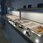 Long hot breakfast buffet selection with chef area further down.