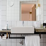 Lovely vanity with the shower behind this wall