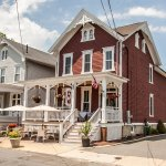 Our lovely renovated Victorian offers seasonal porch seating
