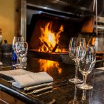 Guests can eat fireside by the grill and watch our chef's 'preform'