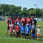 Mayfly Gang kids with some Senators players
