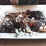 Chocolate sharing platter. Cake, fudge brownie, ice cream, marshmallows, meringue, strawberries