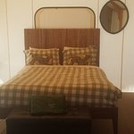 inside the Glamping cabin queen bed, futon, table and chairs