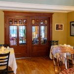 Beautiful pocket French doors separating lounge area from Dining area.