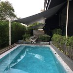 Ground floor pool and dining area