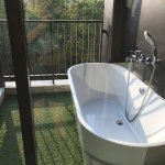 Outdoor tub in addition to indoor shower