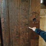 The Bullet holes in the old wooden door.