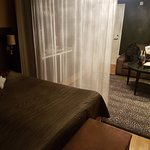 A light curtain separates the double bed