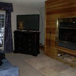 """Jr Suit #45: wood burning fireplace and 50"""" TV."""