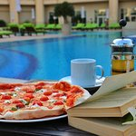 Pizza by poolside