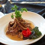 Rack of Lamb : Grilled rack of lamb served with shiitake mushrooms, green peppercorns & sweet ba