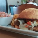 Meatloaf sandwich with fries and slaw.