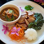 Duck with Curry : Roasted duck served with kaffir lime leaves and Thai curry cream sauce.